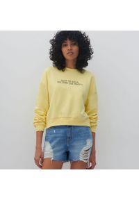 Żółta bluza Reserved z napisami