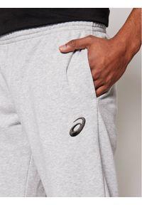 Asics Spodnie dresowe Small Logo 2031A981 Szary Regular Fit. Kolor: szary. Materiał: dresówka