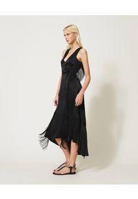 TwinSet - Długa sukienka z mieszanki jedwabiu i satyny z frędzlami Twinset. Kolor: czarny. Materiał: jedwab, satyna. Długość rękawa: bez rękawów. Typ sukienki: asymetryczne. Styl: klasyczny. Długość: maxi