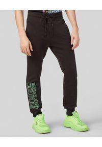 Versace Jeans Couture - VERSACE JEANS COUTURE - Czarne spodnie dresowe z logo. Kolor: czarny. Materiał: dresówka. Wzór: nadruk