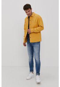 Tommy Jeans - Koszula bawełniana. Typ kołnierza: kołnierzyk włoski. Kolor: żółty. Materiał: bawełna. Długość rękawa: długi rękaw. Długość: długie. Wzór: gładki