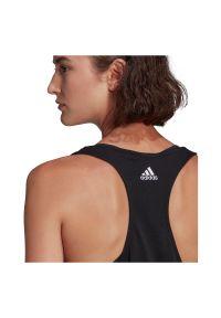 Adidas - Koszulka damska adidas Loungwear Essentials Loose Logo Tank GL0566. Materiał: bawełna, materiał. Sport: fitness