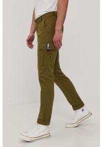 Tommy Jeans - Spodnie. Okazja: na co dzień. Kolor: zielony. Styl: casual