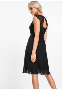 Czarna sukienka bonprix w koronkowe wzory