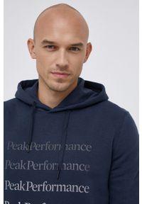 Peak Performance - Bluza. Kolor: niebieski. Materiał: bawełna, dzianina. Wzór: gładki, nadruk