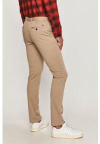TOMMY HILFIGER - Tommy Hilfiger - Spodnie. Okazja: na co dzień. Kolor: beżowy. Styl: casual