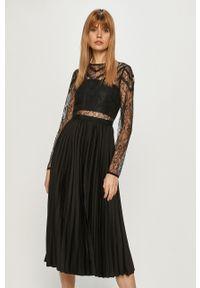 Morgan - Sukienka. Kolor: czarny. Materiał: koronka. Typ sukienki: rozkloszowane, plisowane