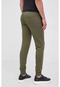 United Colors of Benetton - Spodnie. Kolor: zielony. Materiał: dzianina