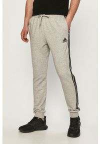 Adidas - adidas - Spodnie. Okazja: na co dzień. Kolor: szary. Materiał: dzianina, poliester. Wzór: nadruk, melanż. Styl: casual