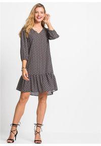 Sukienka z poliestru z recyklingu bonprix czarno-naturalny- truskawkowy z nadrukiem. Kolor: czarny. Materiał: poliester. Wzór: nadruk. Długość: mini