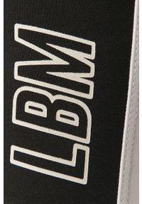 Białe legginsy LABELLAMAFIA z nadrukiem