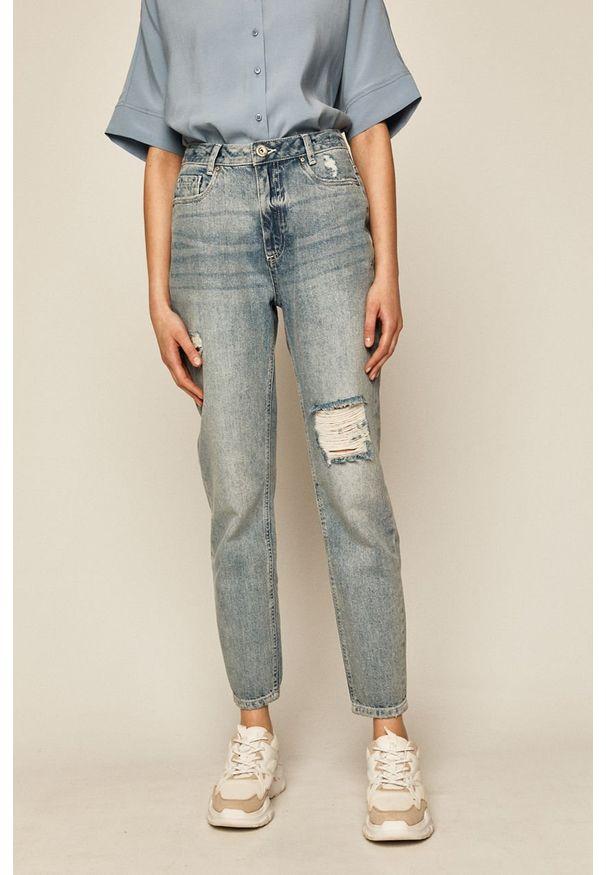 Niebieskie jeansy medicine w kolorowe wzory, boho