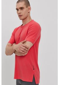 Nike - T-shirt. Okazja: na co dzień. Kolor: różowy. Materiał: tkanina, dzianina, skóra, włókno. Wzór: gładki. Styl: casual