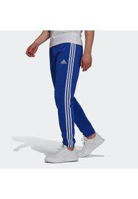 Adidas - Spodnie dresowe męskie. Materiał: bawełna, wiskoza, poliester