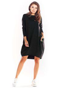 Infinite You - Czarna Bawełniana Luźna Sukienka z Długim Rękawem. Kolor: czarny. Materiał: bawełna. Długość rękawa: długi rękaw