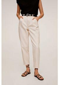 Białe jeansy loose fit mango