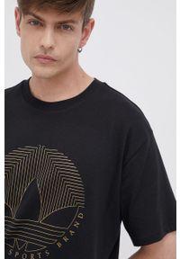 adidas Originals - T-shirt bawełniany. Okazja: na co dzień. Kolor: czarny. Materiał: bawełna. Wzór: nadruk. Styl: casual