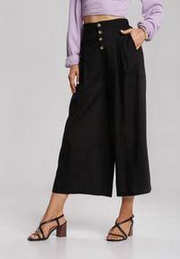 Renee - Czarne Spodnie Amaliphis. Kolor: czarny