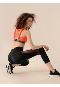 4f - Legginsy treningowe damskie Anna Lewandowska x 4F. Stan: podwyższony. Kolor: czarny. Materiał: mesh, materiał. Wzór: nadruk, gładki. Sport: fitness