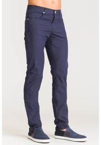 Niebieskie spodnie Versace Jeans z aplikacjami