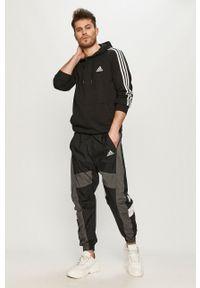 Adidas - adidas - Bluza. Okazja: na co dzień. Typ kołnierza: kaptur. Kolor: czarny. Styl: casual