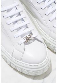 Casadei - CASADEI - Białe sneakersy Off Road Lacroc. Nosek buta: okrągły. Kolor: biały. Materiał: guma. Wzór: napisy