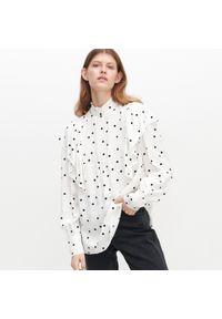 Kremowa bluzka Reserved ze stójką