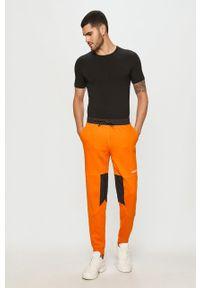 Spodnie dresowe adidas Originals z aplikacjami