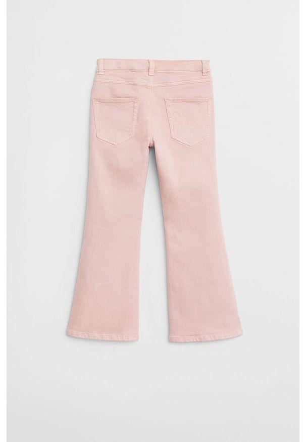 Różowe jeansy Mango Kids w kolorowe wzory