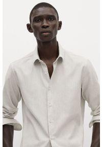 Mango Man - Koszula ALFRED. Typ kołnierza: kołnierzyk klasyczny. Kolor: szary. Materiał: tkanina. Długość rękawa: długi rękaw. Długość: długie. Wzór: gładki. Styl: klasyczny