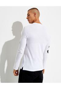 Alexander McQueen - ALEXANDER MCQUEEN - Biała koszulka z logo. Kolor: biały. Materiał: bawełna. Długość rękawa: długi rękaw. Długość: długie. Wzór: nadruk
