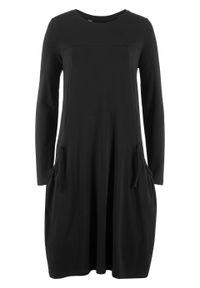 Sukienka oversize z kieszeniami, poszerzana dołem bonprix czarny. Kolor: czarny. Długość rękawa: długi rękaw. Typ sukienki: oversize