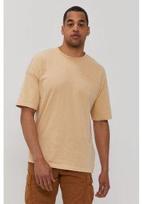 Champion - T-shirt. Kolor: beżowy. Materiał: dzianina. Wzór: gładki