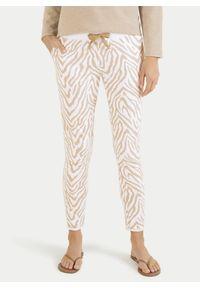 Bawełniane dresy we wzory zebry Juvia. Kolor: biały. Materiał: bawełna, dresówka. Wzór: motyw zwierzęcy