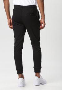Czarne spodnie dresowe Born2be #5