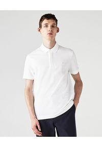 Lacoste - LACOSTE - Biała koszulka polo z bawełnianej piki Regular Fit. Okazja: do pracy, na spotkanie biznesowe. Typ kołnierza: polo. Kolor: biały. Materiał: bawełna. Styl: sportowy, biznesowy, elegancki