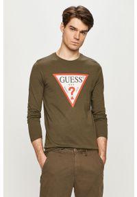 Oliwkowa koszulka z długim rękawem Guess casualowa, z nadrukiem, na co dzień
