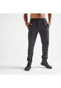 DOMYOS - Spodnie dresowe fitness Domyos 500. Kolor: czarny. Materiał: poliester, elastan, materiał. Sport: fitness