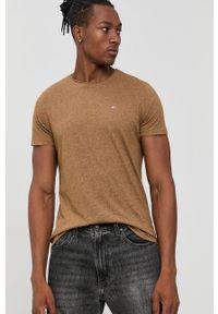 Tommy Jeans - T-shirt. Kolor: beżowy. Materiał: dzianina. Wzór: aplikacja