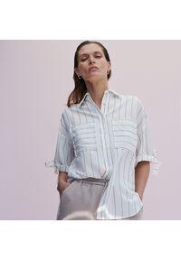 Reserved - Wiskozowa koszula z krótkim rękawem - Kremowy. Kolor: kremowy. Materiał: wiskoza. Długość rękawa: krótki rękaw. Długość: krótkie