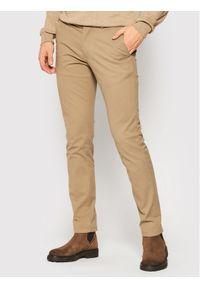 TOMMY HILFIGER - Tommy Hilfiger Spodnie materiałowe Bleecker MW0MW14948 Beżowy Slim Fit. Kolor: beżowy. Materiał: materiał