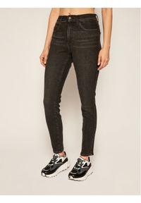 Czarne jeansy slim Wrangler