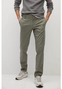 Mango Man - Spodnie DUBLIN. Kolor: brązowy. Materiał: tkanina. Wzór: gładki
