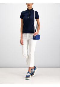 Białe jeansy slim Tory Burch