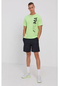 Puma - T-shirt. Kolor: zielony. Materiał: dzianina, materiał. Wzór: nadruk