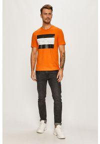 Pomarańczowy t-shirt Calvin Klein z nadrukiem, na co dzień, z okrągłym kołnierzem, casualowy
