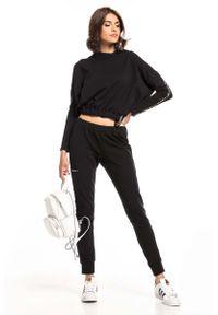 Czarne spodnie dresowe Tessita