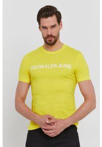 Calvin Klein Jeans - T-shirt. Okazja: na co dzień. Kolor: żółty. Materiał: dzianina. Wzór: gładki. Styl: casual