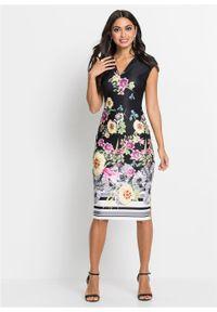 Sukienka w kwiaty bonprix czarny w kolorowe kwiaty. Kolor: czarny. Wzór: kwiaty, kolorowy