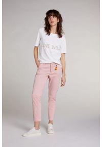 Różowe spodnie w paski, sportowe